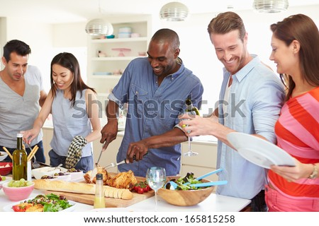 Group Of Friends Having Dinner Party At Home - stock photo