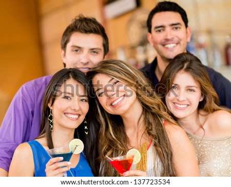 Group of friends having drinks at the bar - stock photo