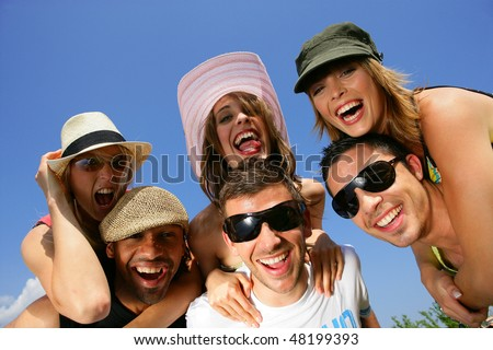 Group of friends having fun in summer vacation - stock photo