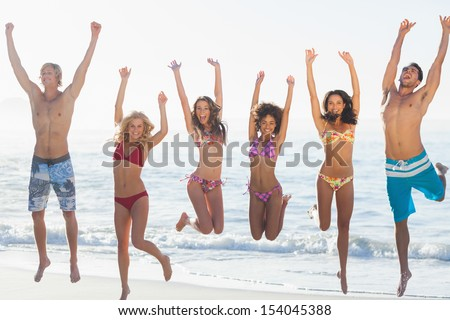 Group of friends having fun on the beach against the sea on holidays - stock photo