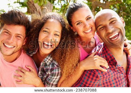 Group Of Friends Having Fun Outdoors Together - stock photo