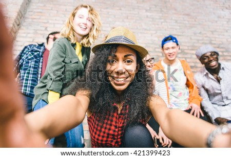 Group of friends having fun together and taking selfies