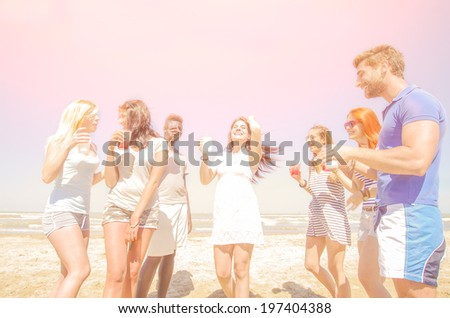Group of friends having party on the beach - beach party - stock photo