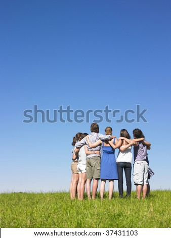 Group of friends holding sholders - stock photo