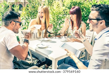 Group of friends in a cafe¨talking and having fun - Young cheerful people meeting in a coffee house - stock photo