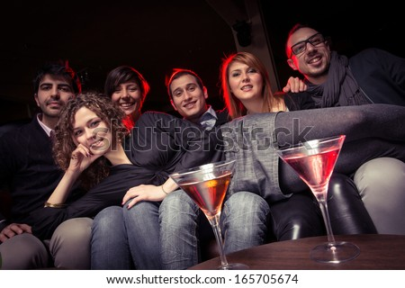 Group of Friends in a Night Club - Stock Image
