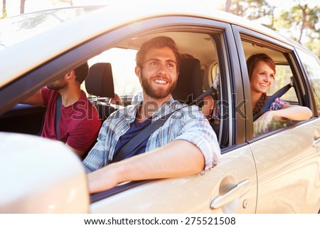 Group Of Friends In Car On Road Trip Together - stock photo