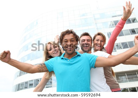 Group of friends in front of building - stock photo