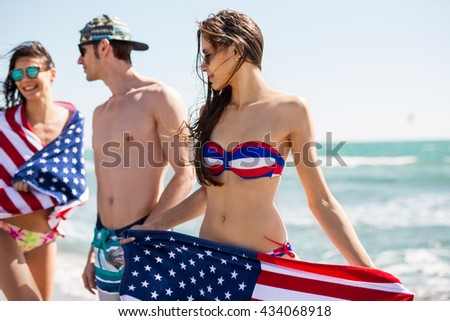 Group of Friends in their twenties dancing on the Beach on 4th of July. Summer concept,  - stock photo