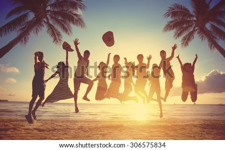 Group of friends jumping against sunset - stock photo