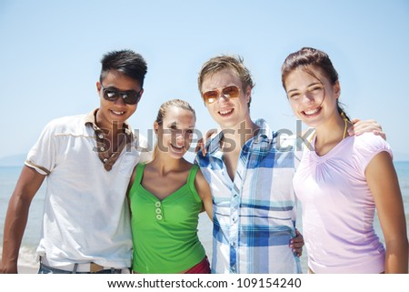 group of friends, looking at camera and smiling - stock photo