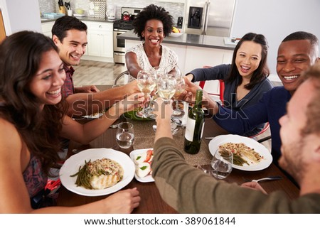 Group Of Friends Making A Toast At Dinner Party - stock photo