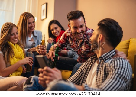 Group of friends making a toast together  - stock photo
