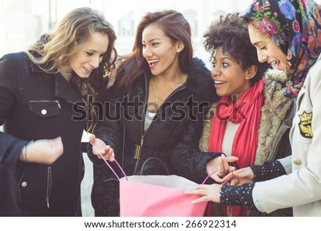 group of friends making shopping together. concept about friendship, shopping, mixed race people. - stock photo
