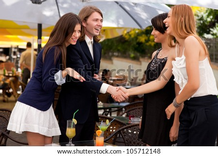 Group of friends meeting for a cocktail. - stock photo