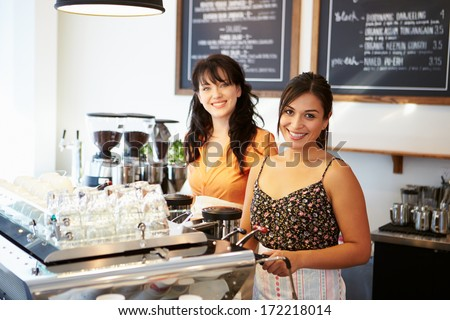 Group Of Friends Meeting In Cafe Restaurant - stock photo