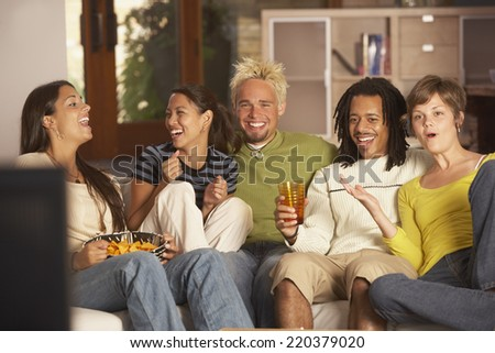Group of friends on couch - stock photo
