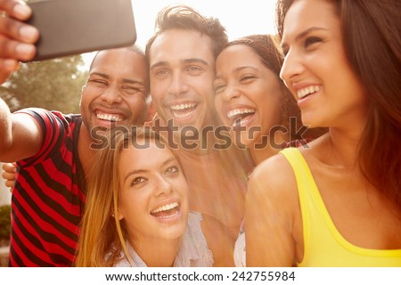 Group Of Friends On Holiday Taking Selfie With Mobile Phone - stock photo