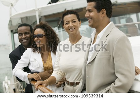 Group of friends on the yacht during vacation - stock photo