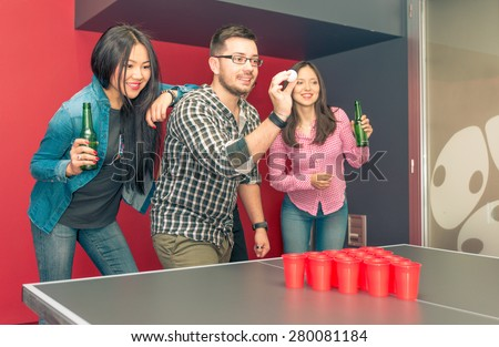 group of friends playing beer pong. concept about students, and games with friends - stock photo
