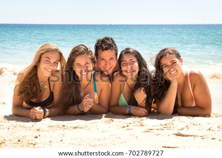 group of friends posing at the beach