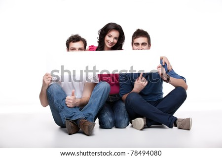 group of friends presenting blank banner - stock photo