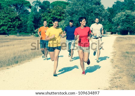 Group of Friends Running Outside