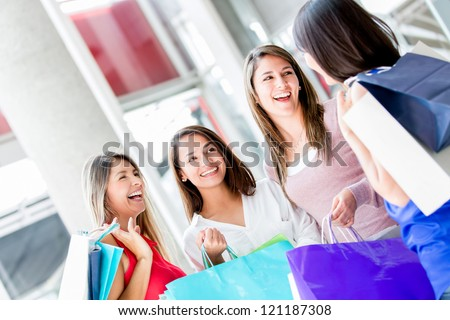Group of friends shopping at the mall - stock photo