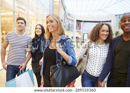 Group Of Friends Shopping In Mall Together