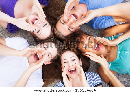 Group of friends shouting - stock photo