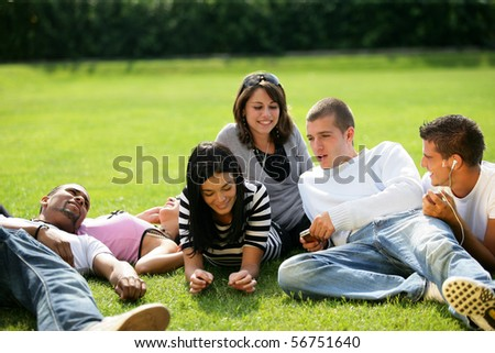 Group of friends sitting in the grass