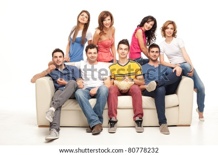 group of friends sitting on couch posing happy