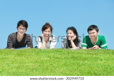 Group of friends studying outdoors at the park