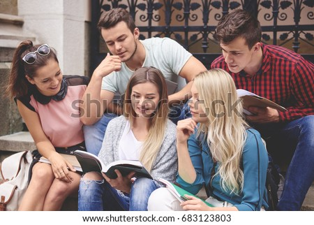 Group of friends studying outside