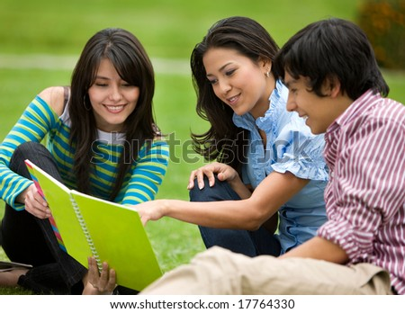 Group of friends studying with their notebooks - smiling outdoors - stock photo