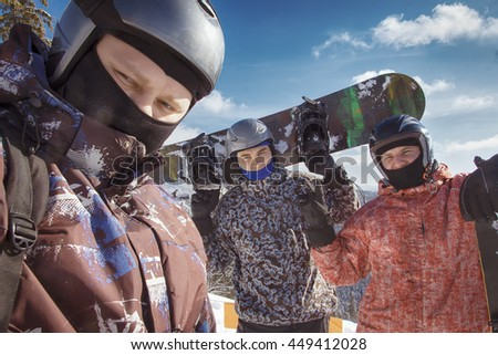 Group of friends taking a selfie. Snowboarders taking a self portrait with mobile phone. Tourists having fun while skiing. People group have fun on ski snow at winter season on mountain and skiing - stock photo