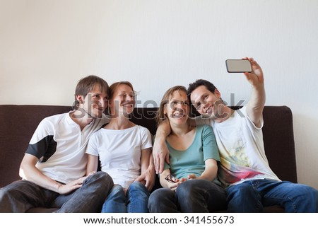 group of friends taking photo of themselves, home party, selfy