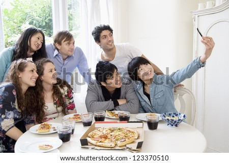 Group of friends taking self portrait photograph - stock photo
