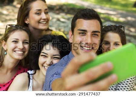 Group of Friends Taking Selfie at Park
