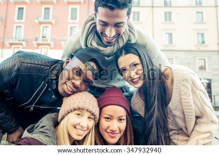 Group of friends taking selfie. Multiracial group putting faces together and take photos - stock photo