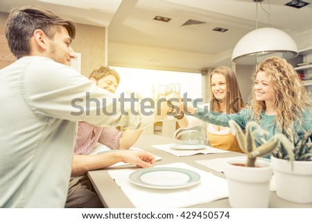 Group of friends toasting with wine before having lunch. concept about friendship and positive mood - stock photo