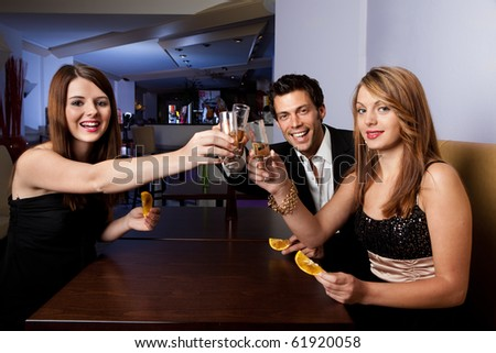 Group of friends together having fun. Focus on the women on the left - stock photo