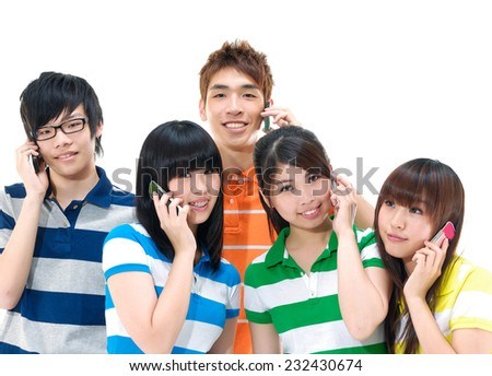 Group of friends use of cellphone  - stock photo