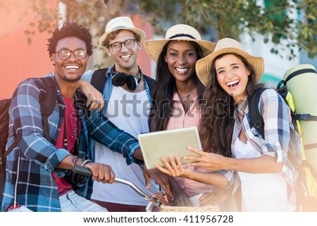 Group of friends using digital tablet - stock photo