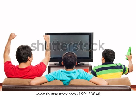 Group of friends watching Sports on TV: blank space on TV - stock photo