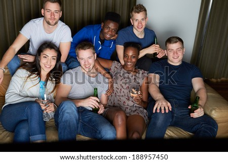 Group Of Friends Watching Television At Home Together - stock photo