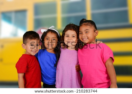 Group of friends who are standing together at bus stop - stock photo