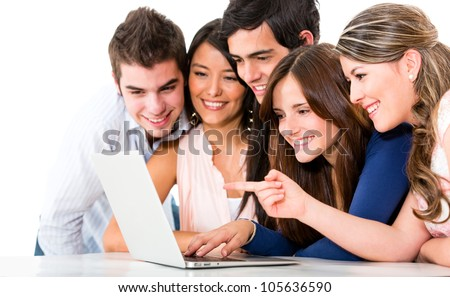 Group of friends with a laptop computer - isolated over white backgorund - stock photo