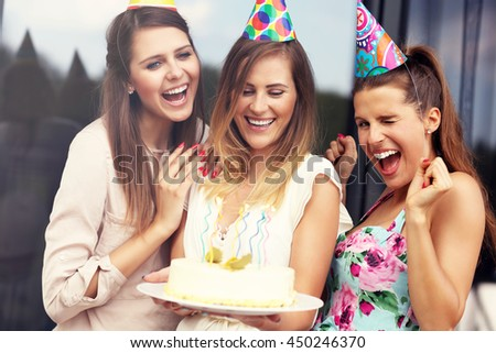 Group of friends with cake celebrating birthday - stock photo
