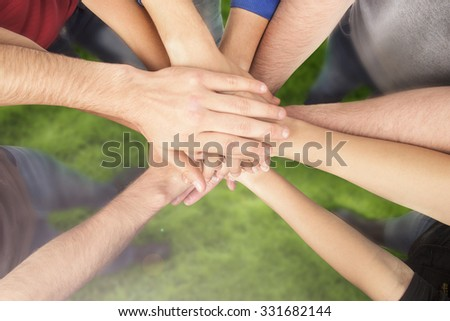 Group of Friends with Hands in Stack, Teamwork